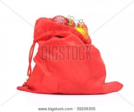 Santa Claus red bag with Christmas toys on white background.