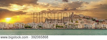 Panoramic View Of The Dalt Vila Of Ibiza On Cloudy Sunset Sky Background. The Fortification Of The C