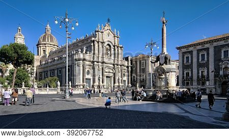 CATANIA, SICILY, ITALY - APRIL 05, 2010: people crowding main square of Cathedral in Catania Old Town, one of most important city of Sicily tourism