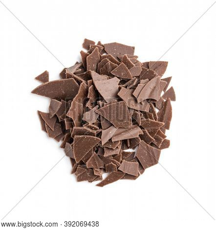 Grated dark chocolate. Chocolate flakes isolated a on white background.