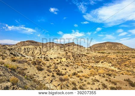Tabernas desert mountains in spanish Desierto de Tabernas. Europe only desert. Almeria andalusia region Spain. Protected wilderness area and location for spaghetti western movies. poster