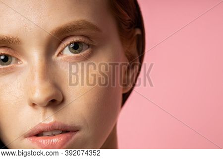 Closeup Cropped Redhead Caucasian Young Woman With Freckled Skin, Beautiful Eyes, No Makeup. Ophthal