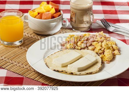 Arepa For Breakfast, Cheese And Scrambled Egg, A Traditional Colombian Dish.