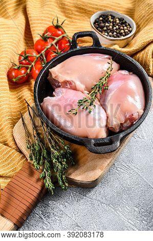 Boneless Raw Chicken Thighs Fillets. White Background. Top View