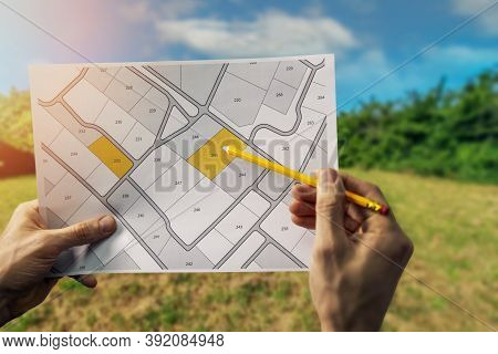 Sale Of Building Plot Of Land For House Construction. Cadastral Map On Field Background