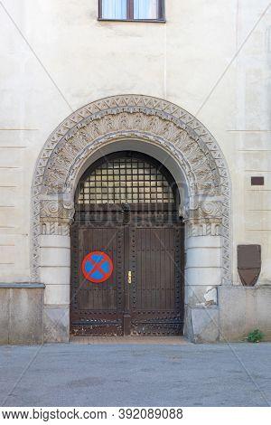 Arch Garage Door With No Parking Sign