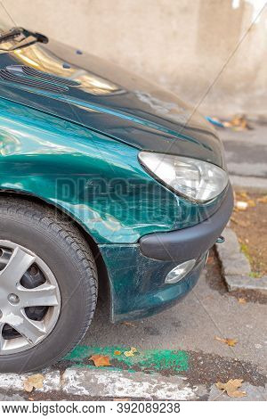 Small Green Car Front Collision Traffic Accident Damage