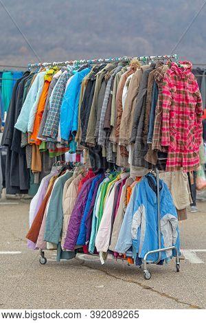 Jackets Clothing Hanging On Rails At Flea Market