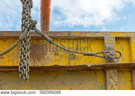 Heavy Lifting Steel Wire And Chains At Dumpster