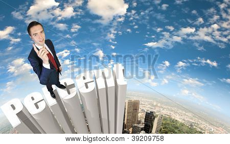 Businessman in suit standing on the word Percent