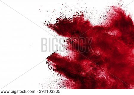 Red Powder Explosion Cloud On White Background. Freeze Motion Of Red Color Dust  Particles Splashing