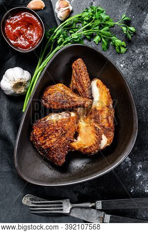 Peking Style Fried Chicken. Black Background. Top View