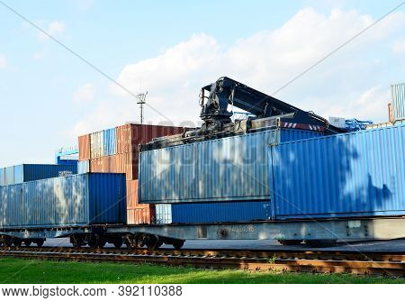 Shipping Container Loading By Richtracker On The Freight Rail Car At Logistic Warehouse Port. Ocean