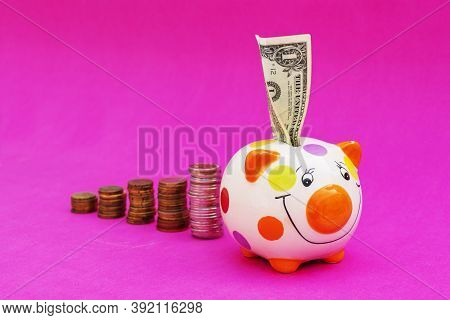Piggybank And Money Tower , To Save , Saving Money For Affordable Things, Financial Concept .piggyba
