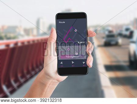 Woman Holding Smartphone Using Navigator App Walking In Urban Area In City. Route Navigation, Travel