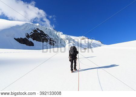Rope Team Mountaineering With Crampons On Glacier Taschachferner Towards Wildspitze And Mountain Sno