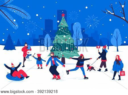 Winter Holiday Festivities Around The Christmas Tree. People Having Fun And Spending Time Outdoors I