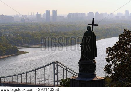 Scenic Landscape View Of Dnipro River With The Pedestrian Bridge And Famous Monument Of Vladimir The