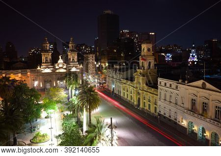 View Of Plaza De Armas Main City Square Of Santiago De Chile At Night.  Long Exposure With Blurred C