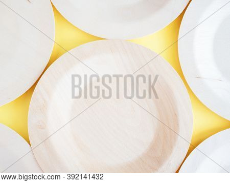 Concept Of Environment Preservation And Protection. Eco Friendly Disposable Plates On Yellow Paper B