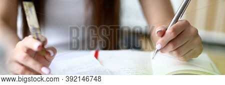 Focus On Tender Businesswoman Hands Holding Metallic Writing Pen And Counting Important Numbers In S