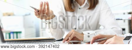 Focus On Smart Businesswoman Sitting Indoors And Holding Metallic Writing Pen. Witty Female Manager