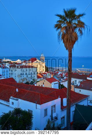 Lisbon panorama of sunset. Portugal. Evening picturesque at houses historic old town in district Alfama.