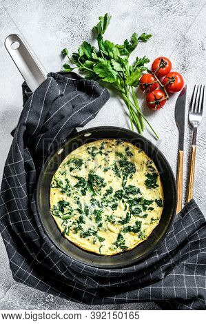 Spinach Cheese Frittata In A Pan. Gray Background. Top View