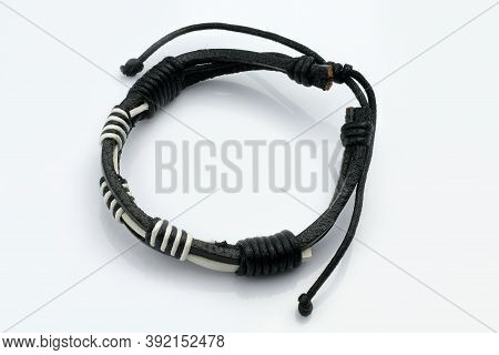 Black And White Leather Bracelet On A Hand On A White Background. Leather Accessories, Arm Bracelet.