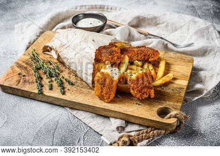 Fish And Chips, French Fries And Cod Fillet Fried In Breadcrumbs. Gray Background. Top View