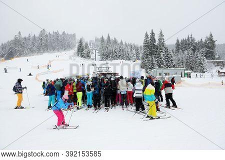 Bukovel, Ukraine - December 25:  The Skiers Waiting For A Lift In Bukovel Ski Resort. It Is The Larg