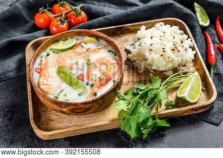 Tom Kha Gai. Creamy Coconut Soup With Chicken And Shrimp. Thai Food. Black Background. Top View