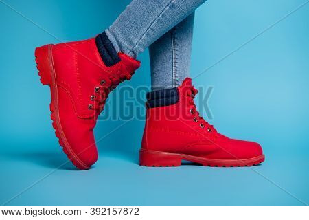 Cropped Profile Photo Of Fit Lady Legs Sneaker Tiptoe Wear Stylish Red Rubber Shoes Boots Denim Jean