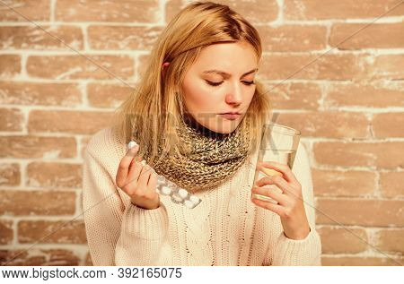 Pills For Breaking Fever. Take Medications To Reduce Fever. Headache And Fever Remedies. Woman Tousl