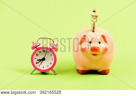 It Is Time To Pay. Piggy Bank Stuffed Dollar Cash And Alarm Clock. Financial Crisis. Banking Account