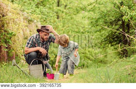 Planting Flowers. Dad Teaching Little Son Care Plants. Little Helper In Garden. Make Planet Greener.