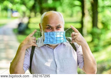Easing Of Lockdown Restrictions. Mask Protecting From Virus. Older People Highest Risk Covid-19. Wea