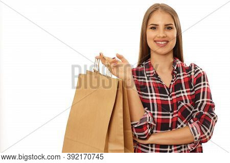 Happy Young Beautiful Woman Smiling To The Camera Posing With Shopping Bags Isolated Copy Space. Che