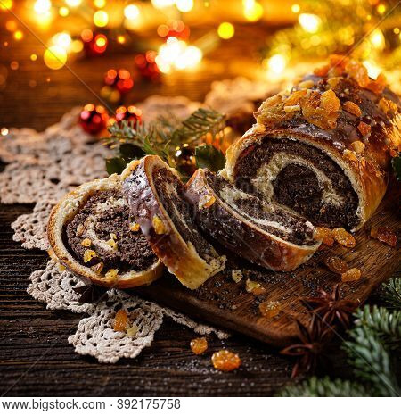 Christmas Poppy Seed Cake, Sliced Poppy Seed Cake Covered With Icing And Decorated With Raisins On T