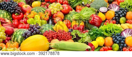 Large fruit colorful panoramic background of fresh and healthy vegetables and fruits.