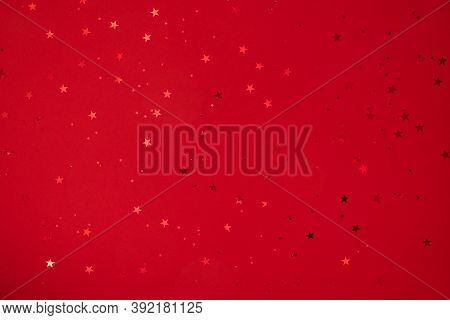 Shining Stars, Sparkles, Confetti On Red Background. Festive Holiday Background. Christmas. Wedding.