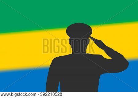 Solder Silhouette On Blur Background With Gabon Flag.