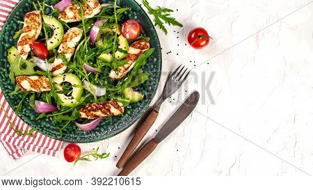 Grilled Halloumi Cheese With Salad Fresh Tomatoes And Avocado. Healthy Food, Diet Lunch Concept. Die