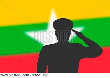 Solder Silhouette On Blur Background With Myanmar Flag.