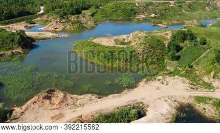 Flooded Sand Quarry Near Sychevo. Lush Green Summer Landscape For Outdoors Vacation, Hiking, Camping