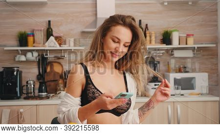 Sexy Attractive Blonde Lady In Black Lingerie Chatting On Phone During Breakfast Enjoying The Time.