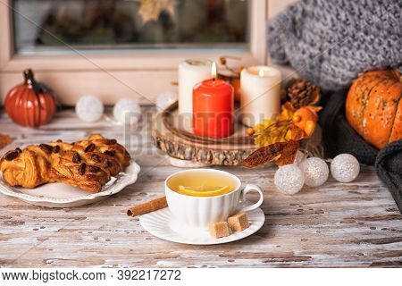 Pumpkins And Pastries With Pecan On The Sill Window, Rainy Weather