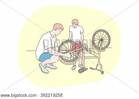 Family, Cycling, Repair, Fathers Day Concept. Man Father Mechanic Dad Daddy Helps Youngster Kid Son