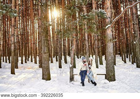 Cozy Winter Holidays In A Nature And Village, Countryside, Hot Drinks And People Concept. Happy Youn