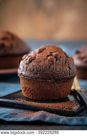 Chocolate Muffins With Chocolate Drops On A Dark Background.